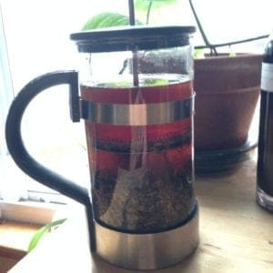 A long infusion steeping in a French press.