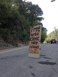 free herbal clinic road sign