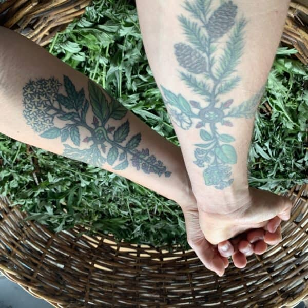 A photo of Katja & Ryn's arms with wedding tattoos displayed.